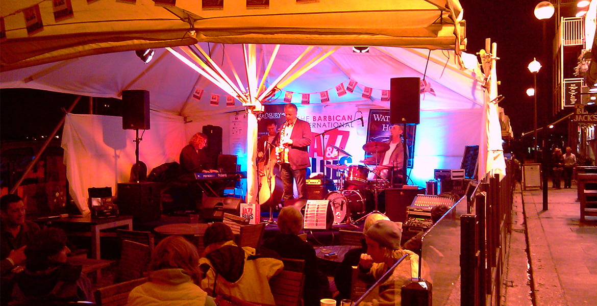 Jazz musicians performing at a festival event.